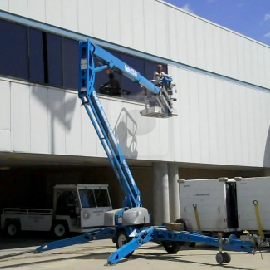 Lift rental- Genie 50 foot trailer mounted articulated lift cleaning windows at Port Columbus International Airport - Columbus, Ohio